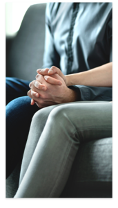 Couple holding hands sitting on couch - closeup on hands - South Jersey Fertility