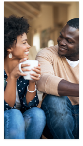 Young black couple smiling over coffee